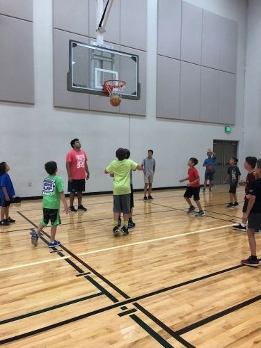 camp picture boys playing basketball